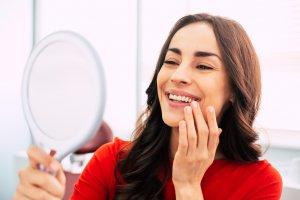 Woman Admiring Dental Work